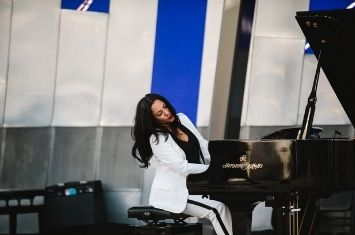 Ambre Hammond playing piano at the AMEB Online Orchestra video reveal in 2018